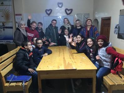 Singing Christmas carols with fellow volunteers