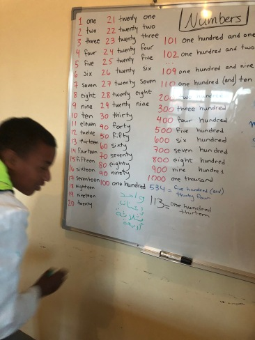 Learning numbers with the Dar Talib (student boarding house) boys