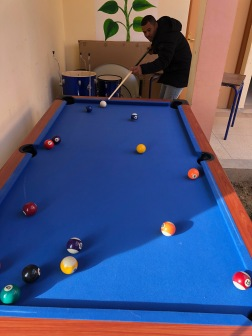 My mudir (supervisor) and I learned how to play pool before putting the table in our new game room.